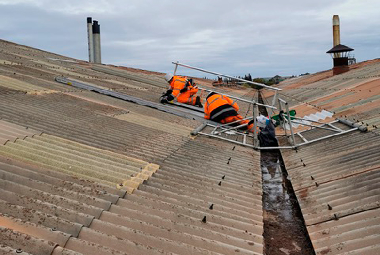 Two Locus Services operatives carrying out skylight cleaning services